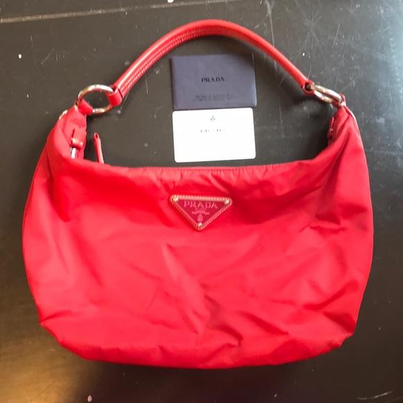 fa3fa7e707cd Red nylon Prada purse - used. M 5ab15ac49cc7ef029eb96cd1